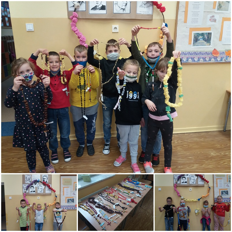 Zdjęcie przedstawia uczniów z konkursowymi różańcami.